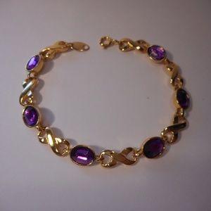 Avon Purple Gold Tone Tennis Style Bracelet
